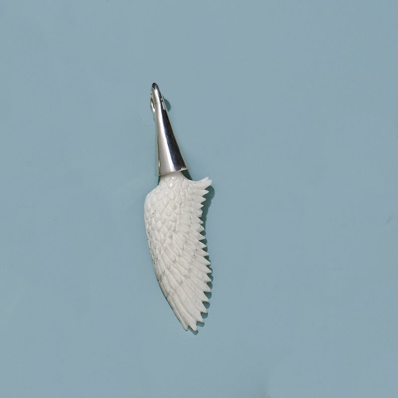 Medium Hand Carved Recycled  Bone Wing with  Cone Silver Cap