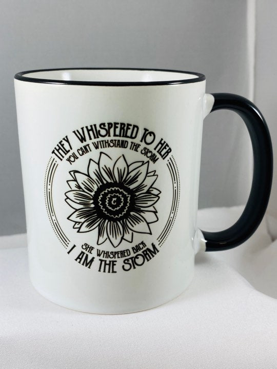 They Whispered to her you can't handle the storm, she whispered back I am the storm ceramic coffee mug