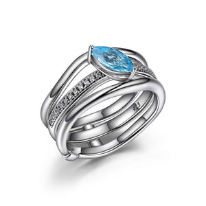 Blue Topaz, Cubic Zirconia and Sterling Silver  Moon Shadow Ring comes with two separate Rings, a Cubic Zirconia Band and a Ring Jacket that sites around it. Wear them seperatly or together  Size 6