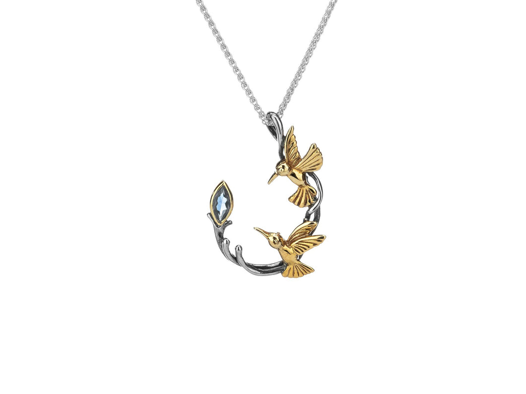 silver and 10k yellow gold hummingbird pendant with marquis blue topaz and chain