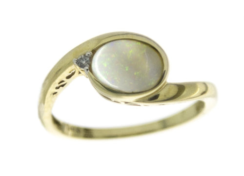 6.75 Opal and Diamond Ring 14k Yellow Gold