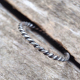 Antique Sterling Silver Twist Ring in table crevice
