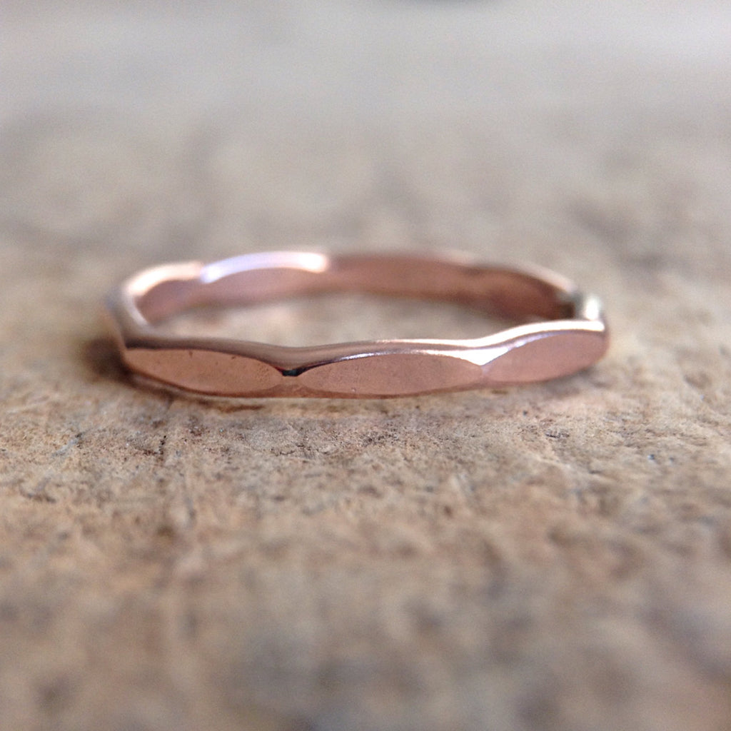 CLose up of 14K Rose Gold Marquis Ring on table
