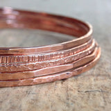 close up of stack of 14K Rose Gold Filled Raw Silk Bohemian Bangle