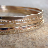 Stack of 14k gold bangles