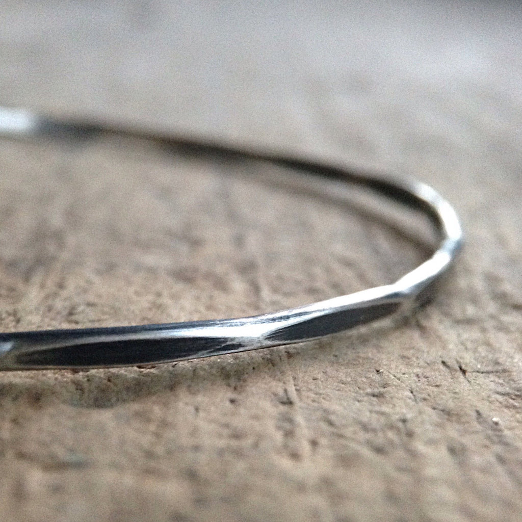 Close up of Antique Silver Marquis Bohemian Bangle on table