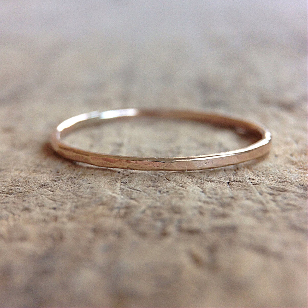 Close up of a 14 gold stacking ring on table