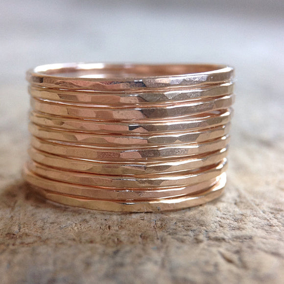 A vertical stack of gold filled skinny rings