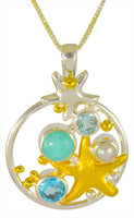 Sterling Silver and 22K gold vermeil pendant with Sky Blue Topaz, White Freshwater Pearl, Baby Blue Topaz, and Amazonite