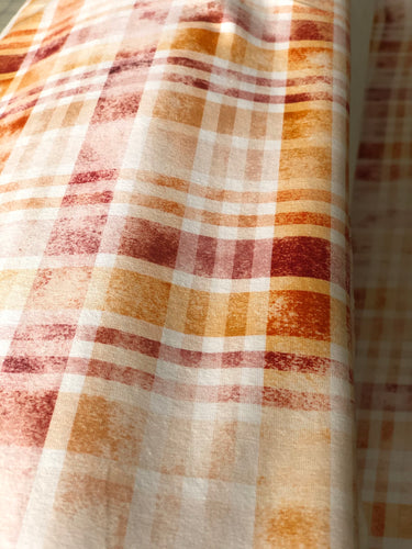 Maroon, pumpkin and white distressed plaid