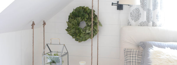 Updating the bedroom with a fresh magnolia wreath