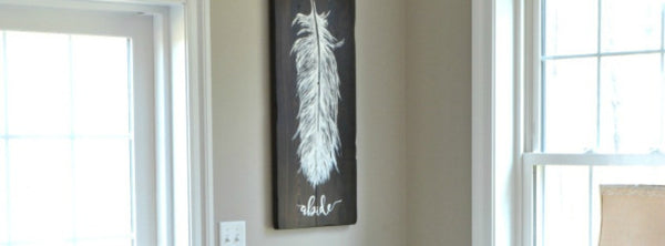 Feather painting on reclaimed wood