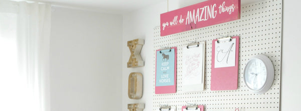 A peg board for the girls' room