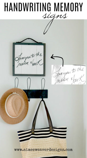 "handwriting memory sign on wood ""love you to the moon and back"" hanging above hat and bag"