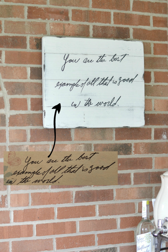 "Handwriting memory sign on white wood hanging on brick wall ""you are the best"""