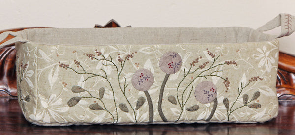appliqued sewing box with quilted base