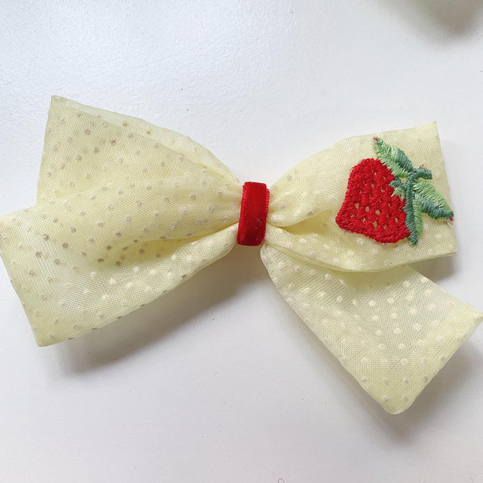 Yellow Swiss dot with strawberry appliqué on ret velvet bow