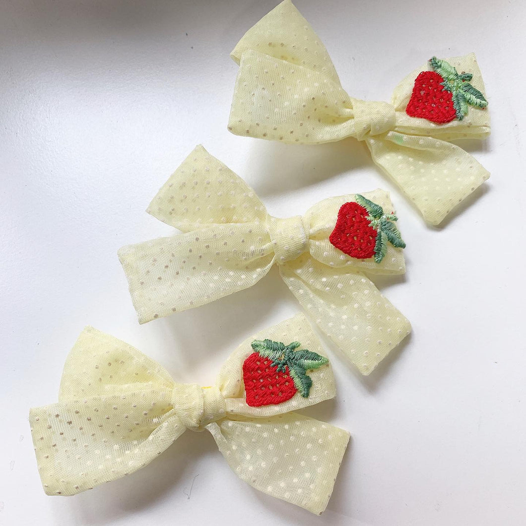 Yellow Swiss dot with strawberry appliqué tie knot