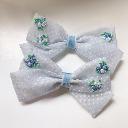 Blue Swiss dot with flower appliqué