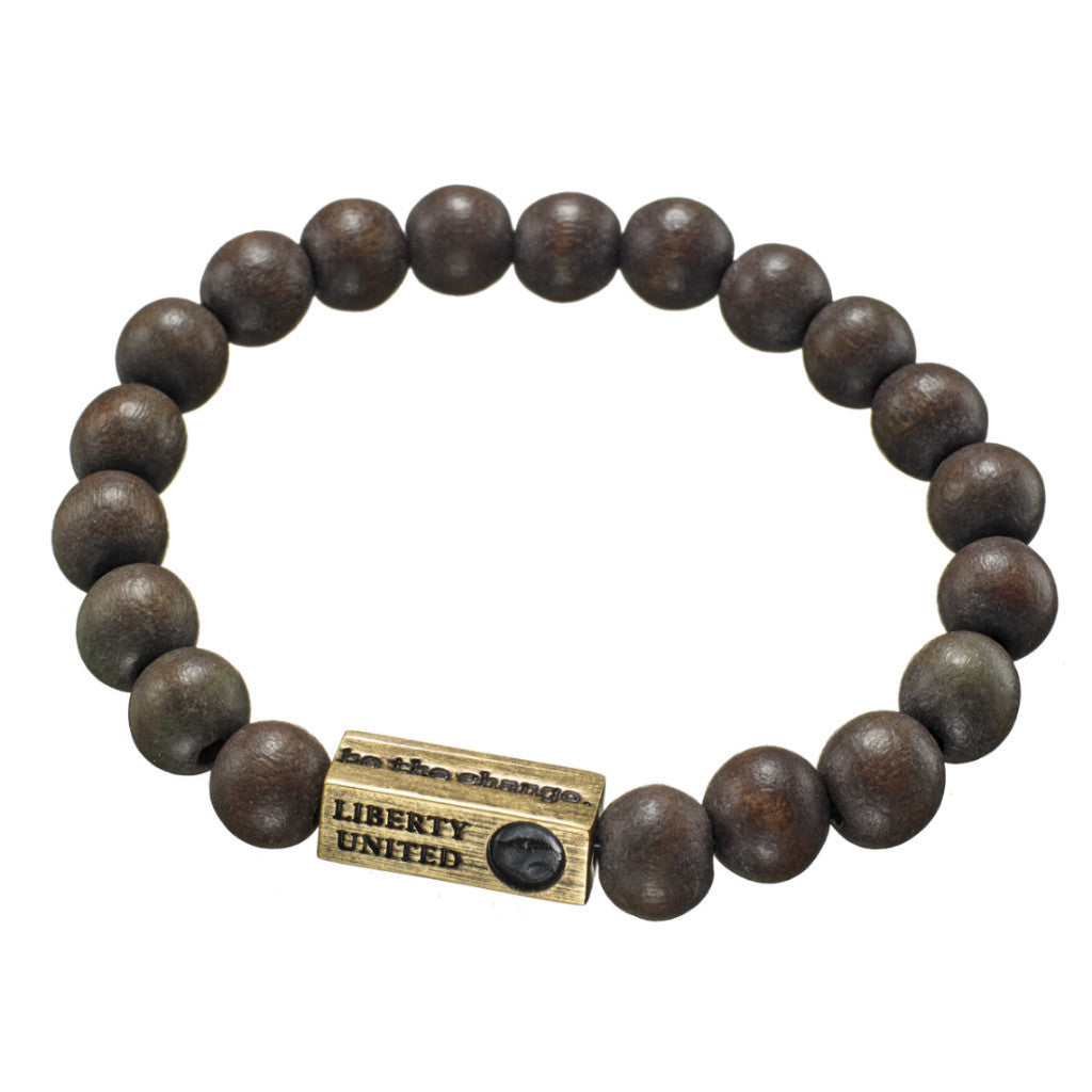 be the change.  brown wood bracelet