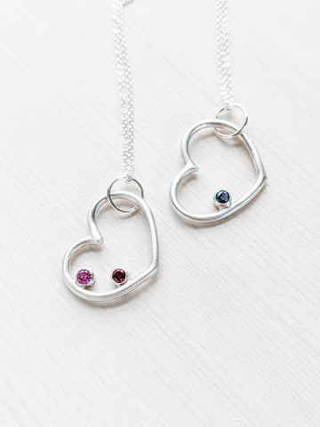 Silver personalized heart pendant with faceted birthstones