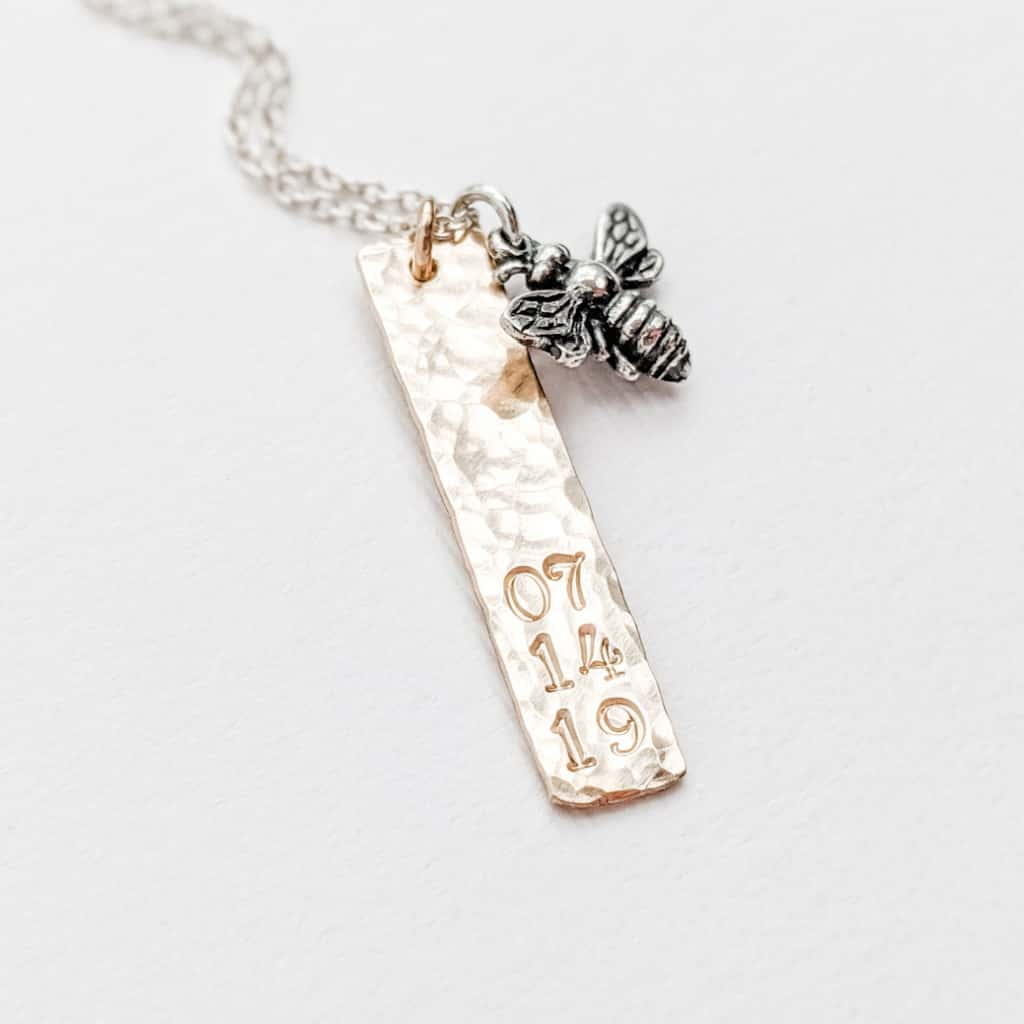 14k gold fill vertical bar charm with date stamped on the bottom of tag. Charm hangs on a sterling silver chain with a sterling silver honey bee charm, a Remembrance necklace for Family Member.