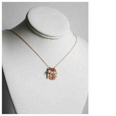 Piccola Jewelry pink gold initial necklace