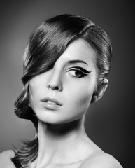 A black and white image of a woman model staring at the camera.