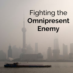 "Pollution infiltrating a city. The words, ""Fighting the omnipresent enemy"" are superimposed on top."
