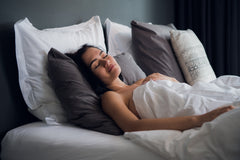 woman sleeping in comfortable bedding