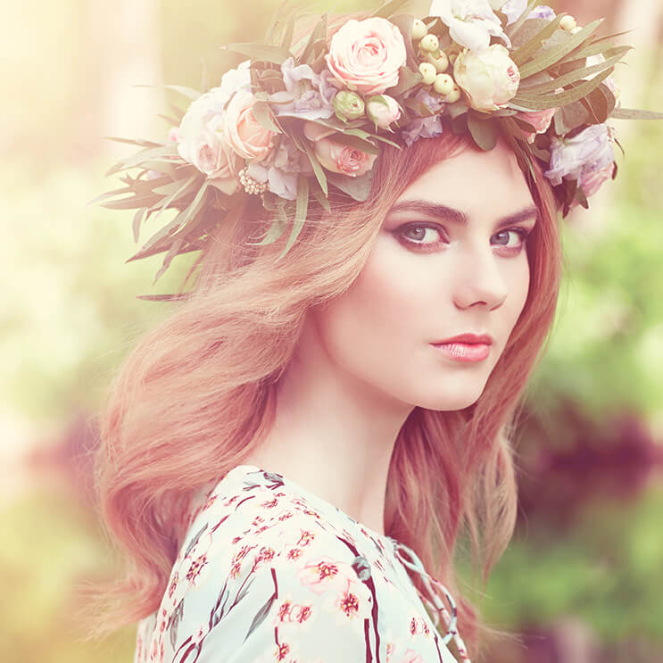 girl wearing flower crown with wind blowing her hair