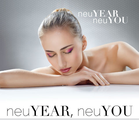 "A woman lying her head on a table. The words ""neuYEAR, neuYOU"" are superimposed on top of the image."