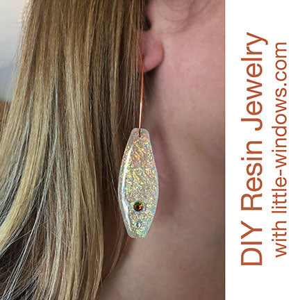 resin jewelry earrings doming long opal texture film on display
