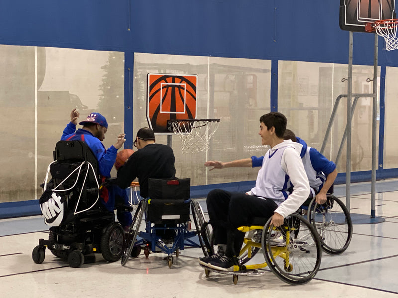 Team Midas plays Wheelchair Basketball