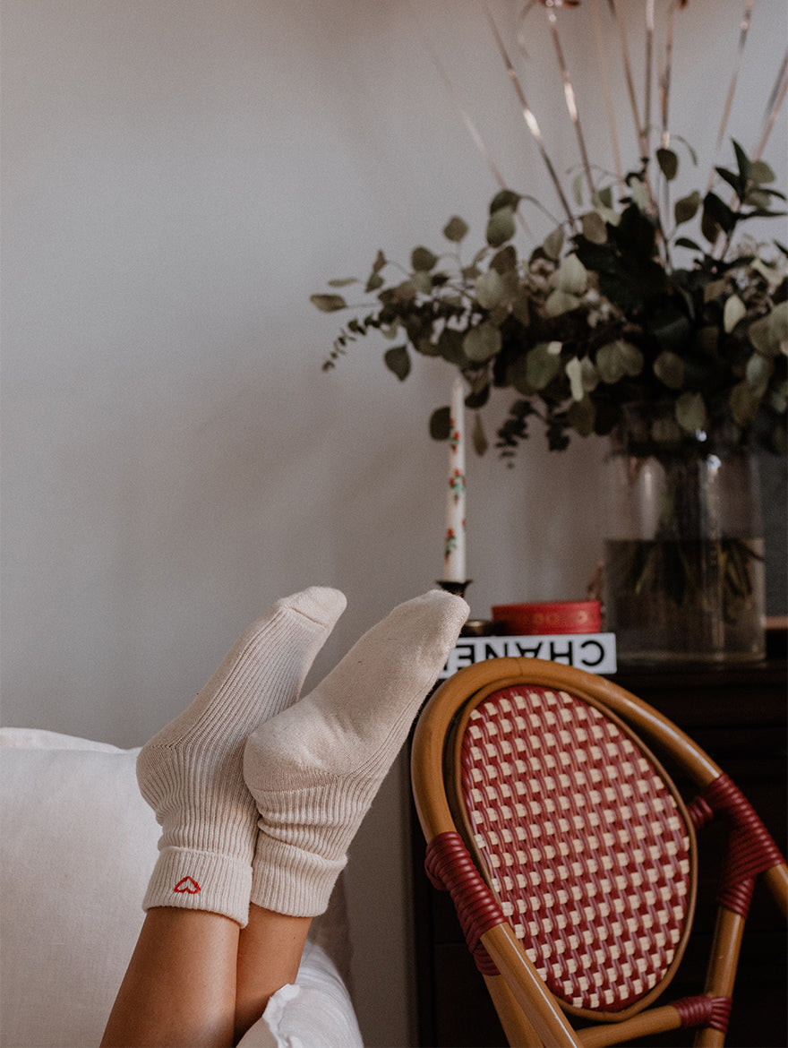 Hand-embroidered cashmere socks in White
