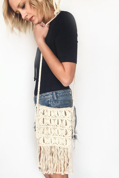 CROSS BODY BRAIDED BAG