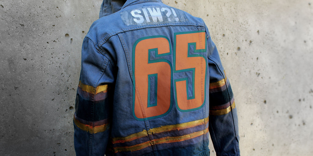 Back of Stick It Wear?! custom hockey style denim jacket.