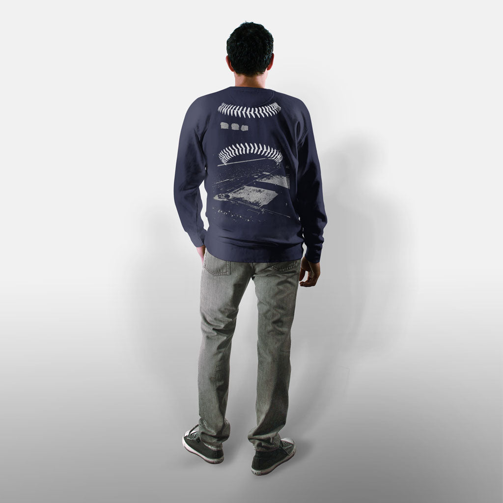 Model wearing Stick it Wear?! 'BOROUGH BALL' baseball Front Office sweatshirt in navy.