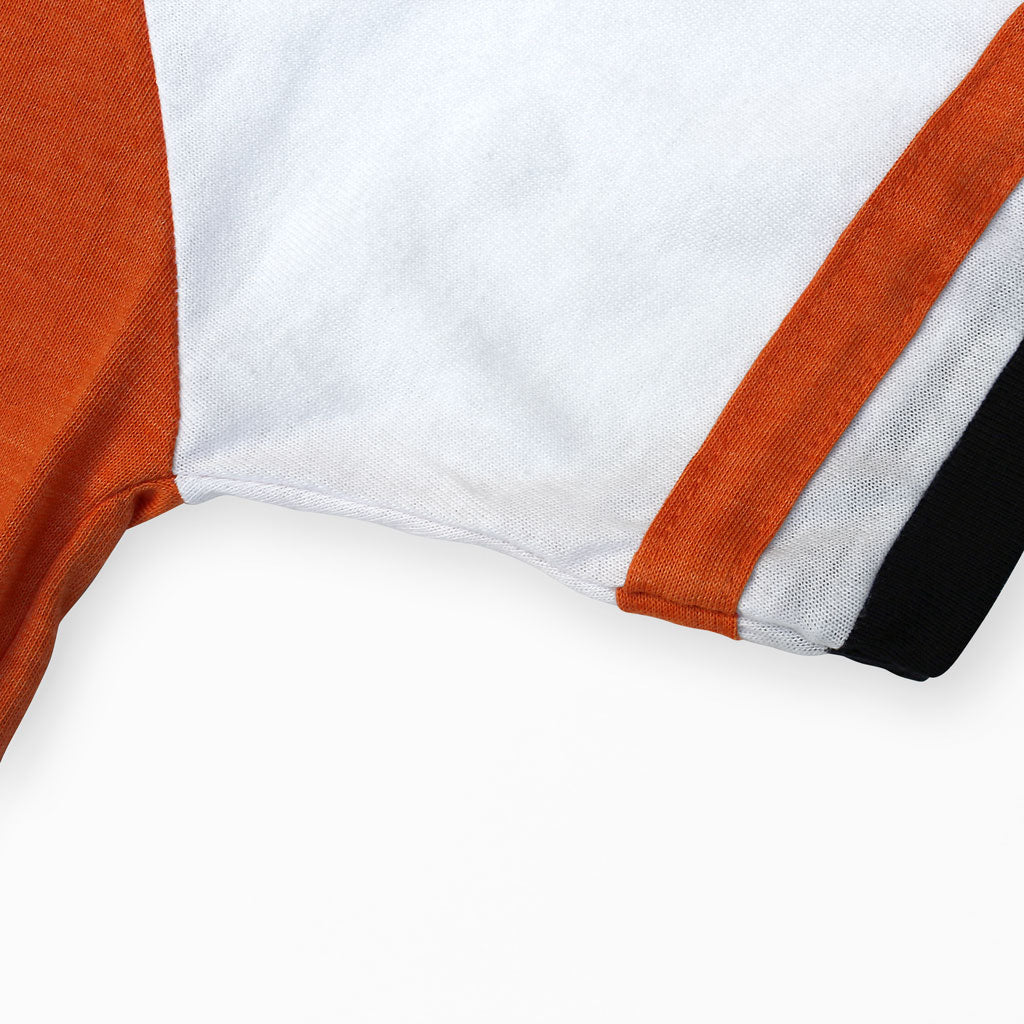 Sleeve of Stick it Wear?! 'CHIBA '94' vintage style Japan league baseball t-shirt in orange.