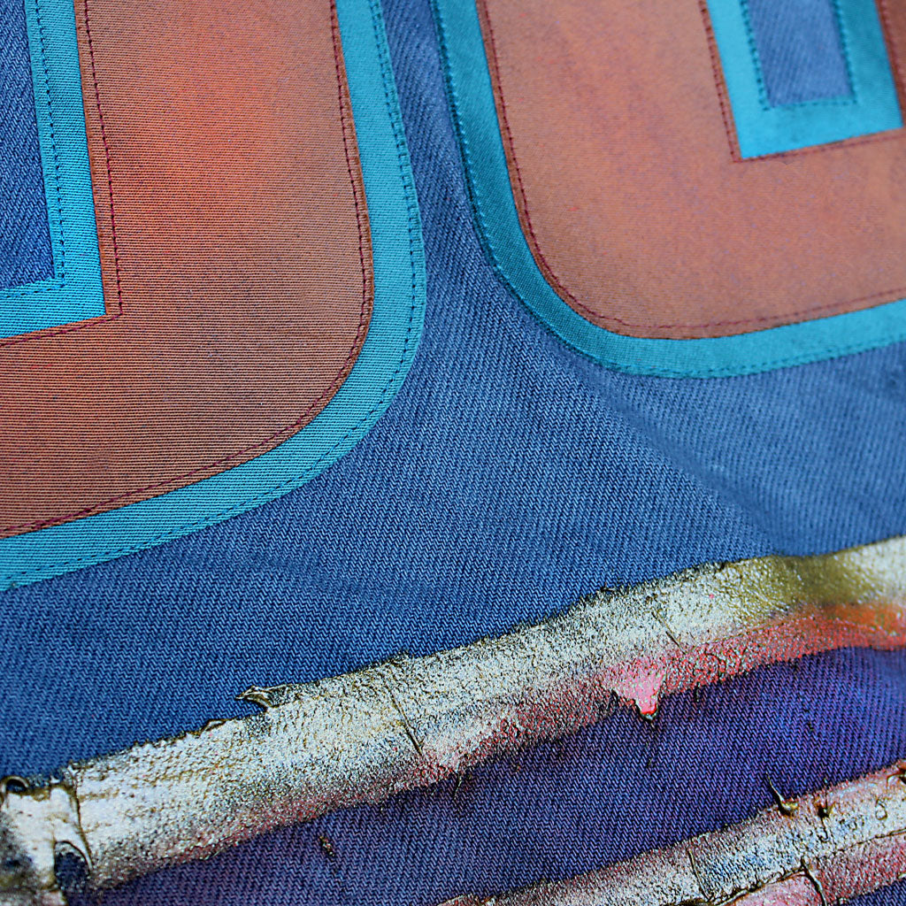 Back detail of Stick It Wear?! 'No 65' Custom Hockey Style Denim Jacket in blue with jersey numbers.