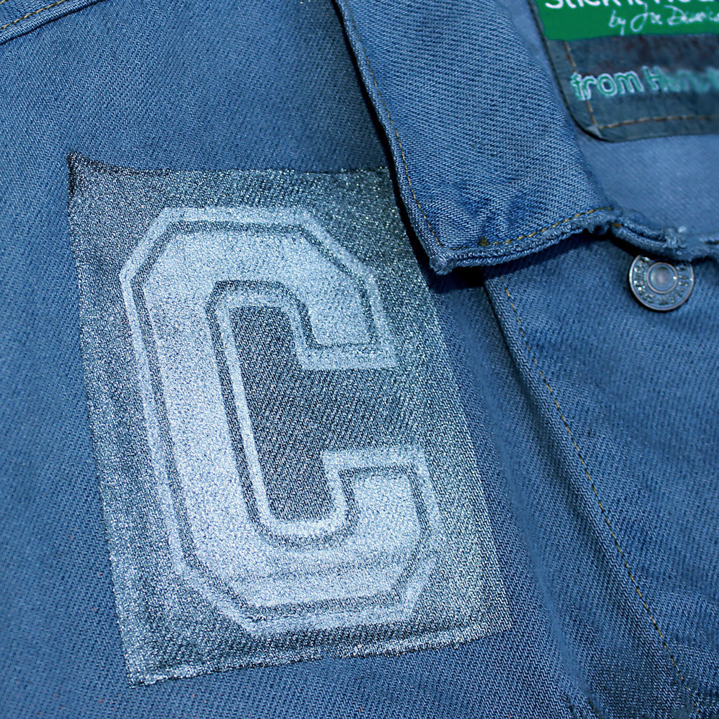 Front collar of Stick It Wear?! 'No 65' Custom Hockey Style Denim Jacket in blue with jersey numbers.