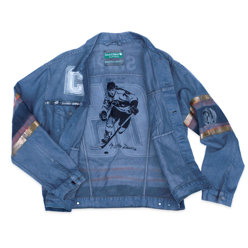 Inside of Stick It Wear?! 'No 65' Custom Hockey Style Denim Jacket in blue with jersey numbers.