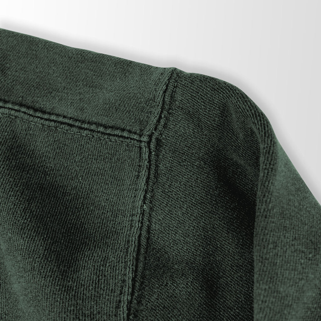 Shoulder of Stick it Wear?! 'FITTING' Football Front Office sweatshirt in green.