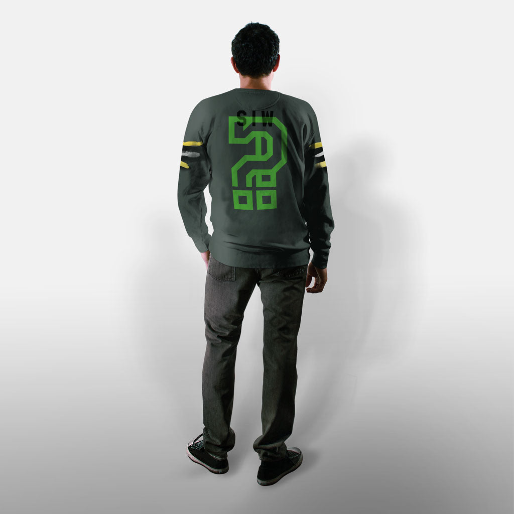 Model wearing Stick it Wear?! 'FITTING' Football Front Office sweatshirt in green.