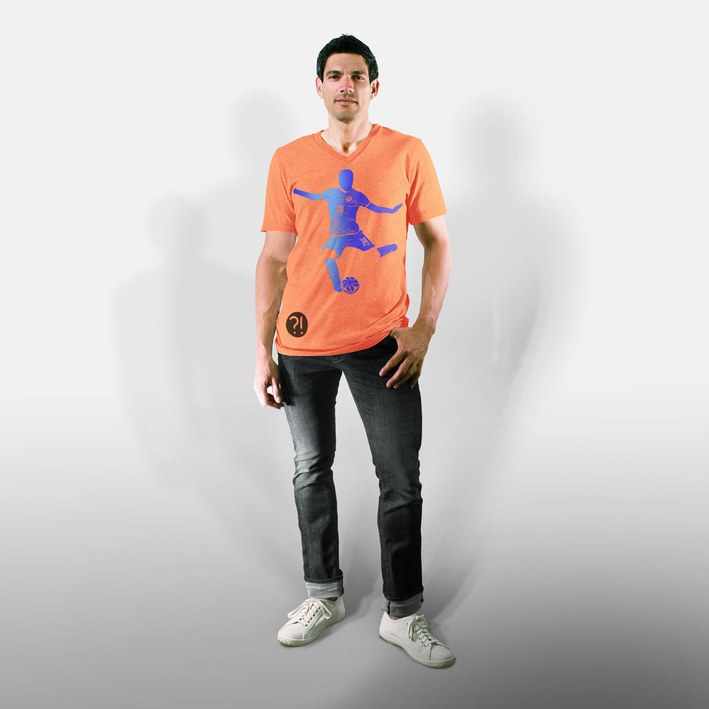 Model wearing Stick It Wear?! 'FLYING DMAN' Soccer V-Neck t-shirt in orange.
