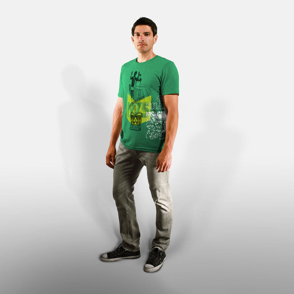 Model wearing Stick it Wear?! 'GRASS CHAMPION' Men Tennis T-shirt in green.