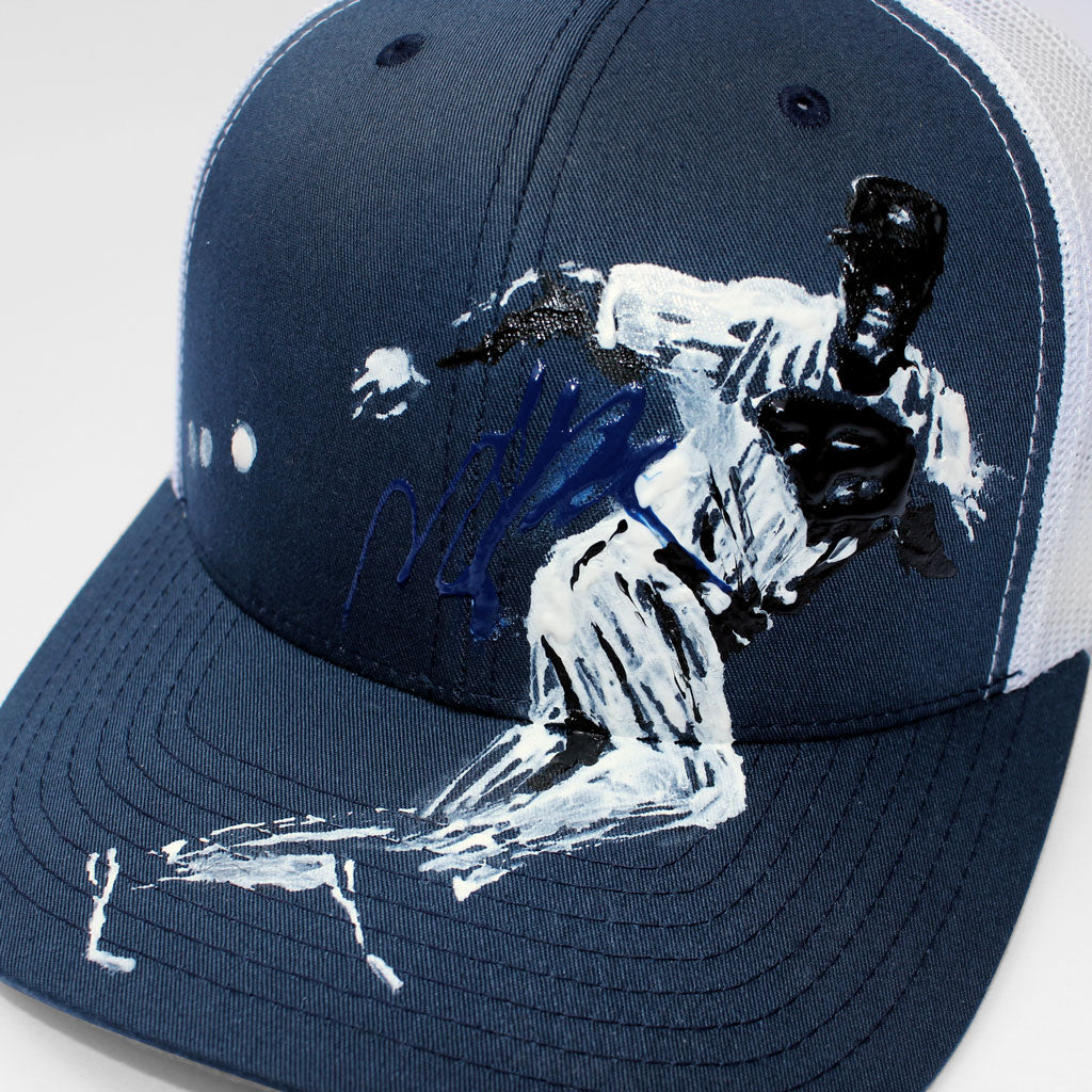 Front detail of 6 panel Stick It Wear?! navy & white baseball cap with brim.