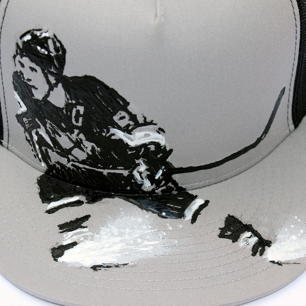 Front detail of 5 panel Stick It Wear?! gray & black, high crown, snapback hockey cap with brim.