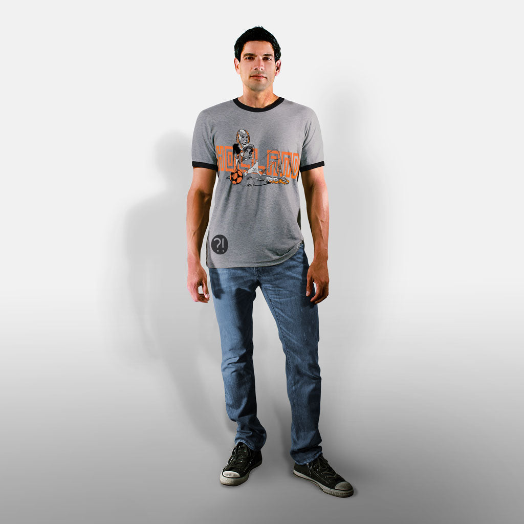 Model wearing Stick it Wear?! HOLLAND Prideful Soccer Vintage Ringer t-shirt in heather gray.