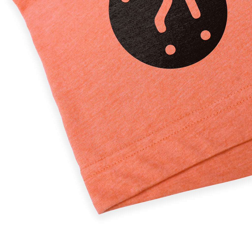 Bottom hem of Stick It Wear?! 'MONF DIVER' First Serve Tennis Tee in orange.